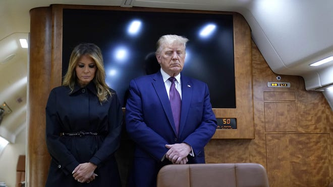 President Donald Trump and first lady Melania Trump pause for a moment of silence on Air Force One as he arrives at the airport in Johnstown, Pa., on his way to speak at the Flight 93 National Memorial, Friday, Sept. 11, 2020, in Shanksville, Pa.