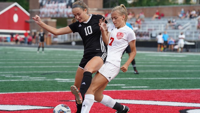 New Philadelphia  and Dover battled to a 1-1 draw in girls high school soccer action at Woody Hayes Quaker Stadium Saturday night. Photo by Solid Rock Photos