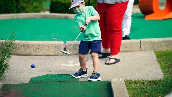 Declan Aubin, 5, shows perfect form at Bakers Golf Center during a Labor Day mini-golf outing in Lanesboro on Monday.