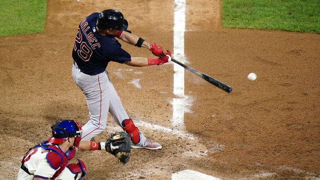 The Boston Red Sox's Bobby Dalbec hits a run-scoring single off Philadelphia Phillies pitcher Heath Hembree during the seventh inning of the second game of a doubleheader, Tuesday, Sept. 8, 2020, in Philadelphia.