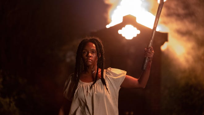 "This image released by Lionsgate shows Janelle Monae in a scene from ""Antebellum."""