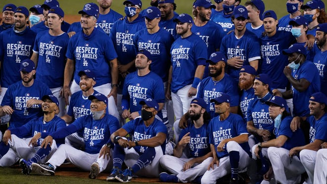 The Dodgers pose for a photo after clinching the NL West title Tuesday night.