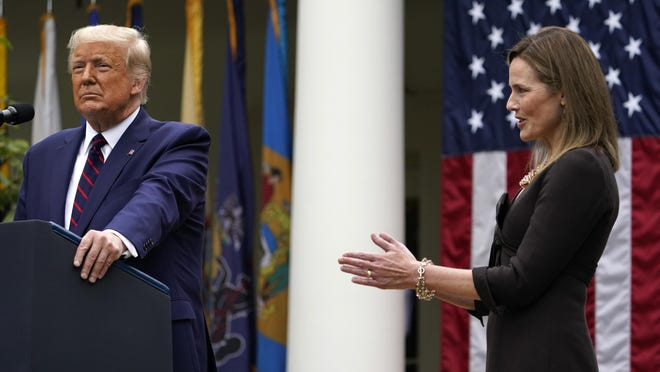 Judge Amy Coney Barrett applauds as President Donald Trump announces Barrett as his nominee to the Supreme Court, in the Rose Garden at the White House, Saturday, Sept. 26, 2020, in Washington.