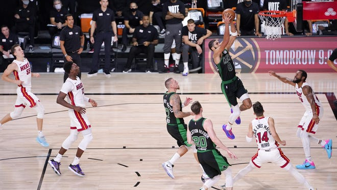 The Celtics' Jayson Tatum goes in for a dunk against the Heat during Friday's Eastern Conference finals game. Boston won, 121-108, and forced Game 6 on Sunday night.