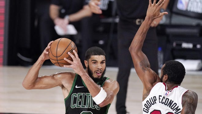 Boston's Jayson Tatum (0) is defended by Miami's Andre Iguodala (28) during the second half of Game 5 of the Eastern Conference Finals in Lake Buena Vista, Fla.