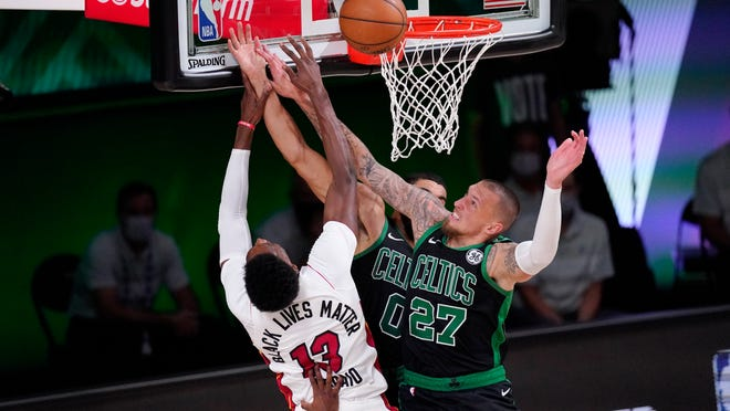 The Celtics' Daniel Theis (27) got the best of the Heat's Bam Adebayo (13) during Friday night's second half.