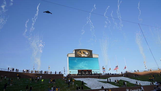 A stealth bomber performs a flyover over a socially-distanced crowd before Missouri's season opener against Alabama at Memorial Stadium on Saturday.