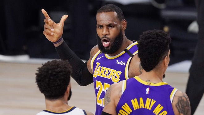Los Angeles Lakers' LeBron James (23) voices his opinion after a play during the Western Conference finals against the Denver Nuggets on Saturday in Lake Buena Vista, Fla. The Lakers play the Miami Heat in the NBA Finals starting tonight.