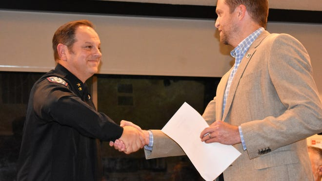 Rollingwood Police Chief Jason Brady, left, celebrates after being sworn in by Mayor Michael Dyson on Oct. 16, 2019.