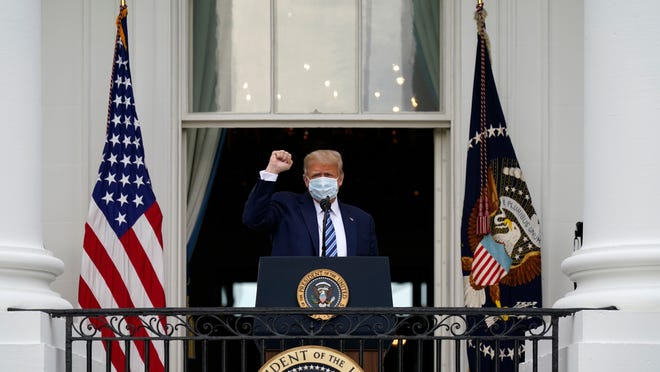 President Donald Trump arrives to speak from the Blue Room Balcony of the White House to a crowd of supporters on Saturday in Washington.