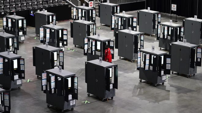 A man participates in early voting Monday at the State Farm Arenain Atlanta.