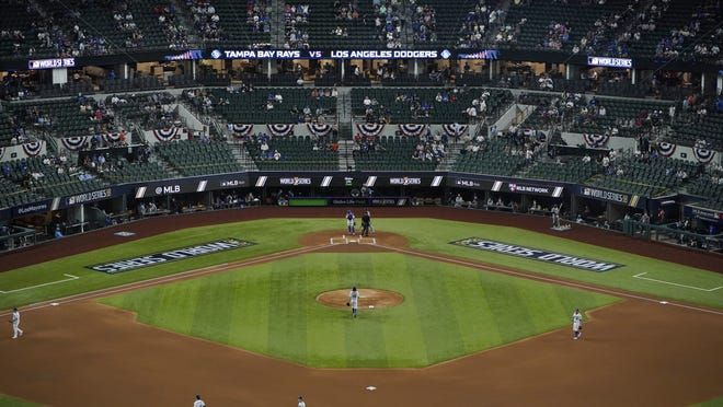 A limited number of spectators watch the Los Angeles Dodgers play the Tampa Bay Rays in Game 2 of the World Series on Wednesday in Arlington, Texas.