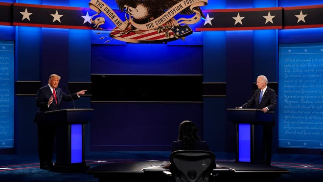 President Donald Trump, left, debates Democratic presidential candidate Joe Biden during the second and final presidential debate Thursday at Belmont University in Nashville, Tenn.