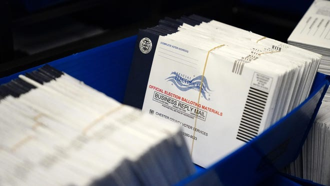 Mail-in ballots are seen after being sorted Friday at the Chester County Voter Services office, in West Chester, Chester County.