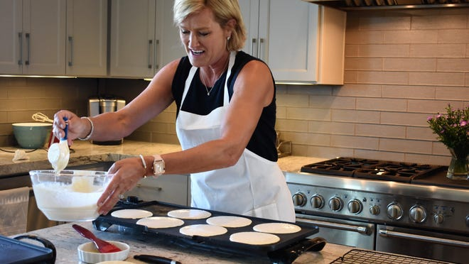 Lakeway resident Astrid Mohn prepares Bergen Flatbread for customers in her Rough Hollow kitchen.