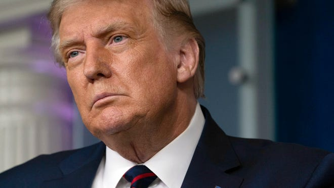 FILE - President Donald Trump pauses while speaking during a media briefing in the James Brady Briefing Room of the White House, Sunday, Aug. 23, 2020, in Washington.