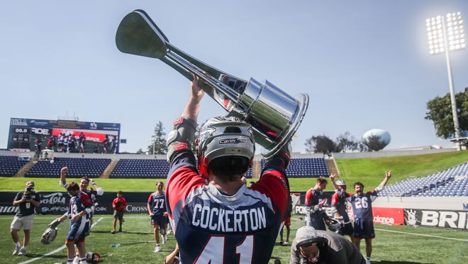 Mark Crockerton raises the Major League Lacrosse championship trophy on Sunday, July 27, 2020 after the Boston Cannons defeated the Denver Outlaws.