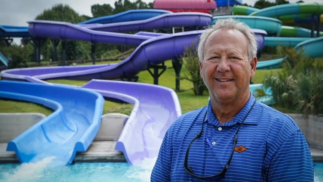 Mark Lazarus, the president and owner of Lazarus Entertainment Group, poses for a picture, Thursday, July 9, 2020, in Myrtle Beach, S.C. Businesses in beach communities and mountain getaways up and down the East Coast are fretting about a shortage of workers as the summer season picks up steam. The concern comes after the Trump administration announced in June that it was extending a ban on green cards and adding many temporary visas to the freeze, including J-1 cultural exchange visas and H-2B visas.