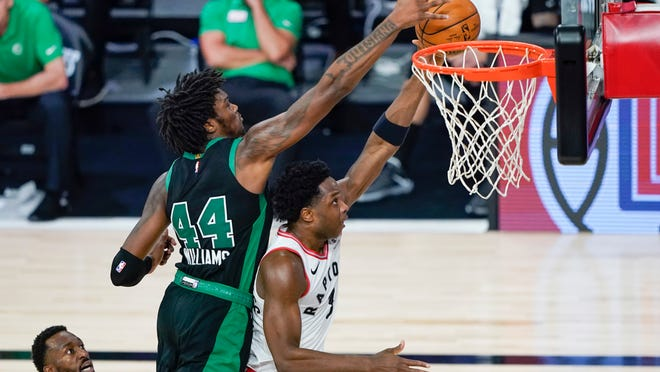 Boston Celtics' Robert Williams III (44) fouls Toronto Raptors' OG Anunoby during the first half of an NBA basketball conference semifinal playoff game Sunday, Aug. 30, 2020, in Lake Buena Vista, Fla.