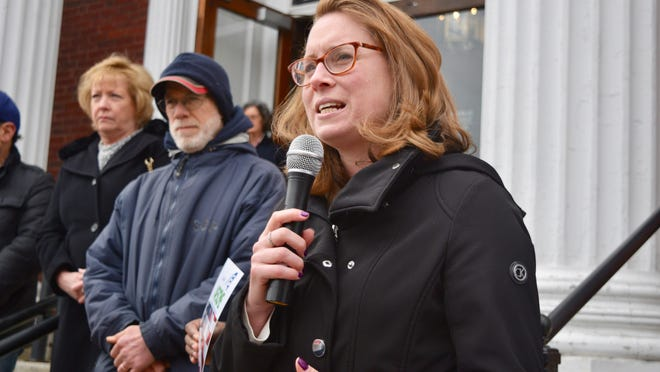 State Rep. Christine Barber speaks outside Somerville City Hall.