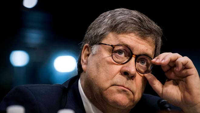 FILE - Then-Attorney General nominee William Barr appears before the Senate Judiciary Committee for his confirmation hearing on Capitol Hill in Washington on Jan. 15, 2019.
