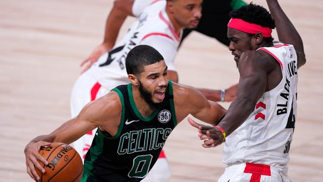 Boston Celtics' Jayson Tatum (0) drives against Toronto Raptors' Pascal Siakam during the second half of an NBA conference semifinal playoff basketball game Friday, Sept. 11, 2020, in Lake Buena Vista, Fla.