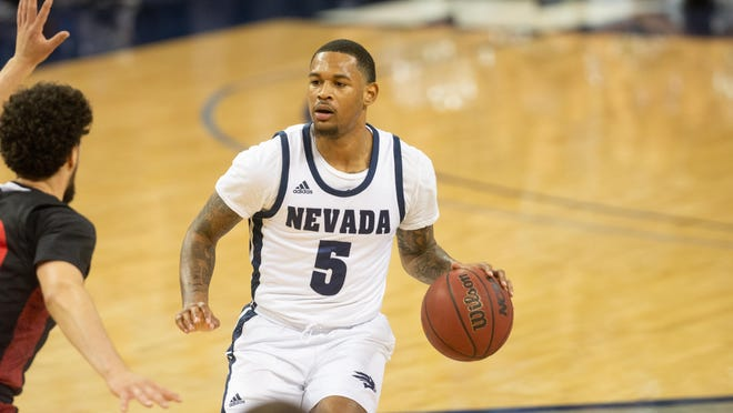 Nevada Wolf Pack guard Nisre Zouzoua (5) brings the ball up the court against the San Diego State Aztec at Lawlor Events Center in Reno, Nev. on Feb. 29, 2020.