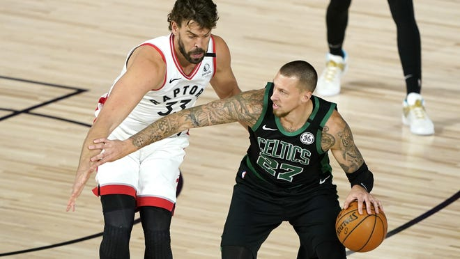 Boston Celtics center Daniel Theis is defended by Toronto Raptors center Marc Gasol during Sunday's Game 1 of the conference semifinals in Lake Buena Vista, Fla.
