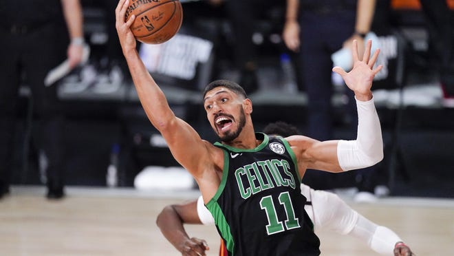 Celtics center Enes Kanter grabs a rebound during the first half of Boston's 121-108 victory over the Heat in Game 5 of the Eastern Conference Final Friday, Sept. 25, 2020, in Lake Buena Vista, Fla. The play of Kanter and starting center Daniel Theis played a large part in the Celtics win.