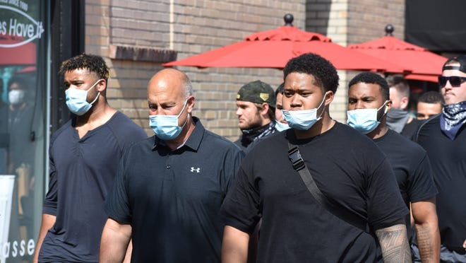 CSU head football coach Steve Addazio marches with team members during a rally June 17, 2020 in Old Town to support a Black teammate who was held at gunpoint last week in Loveland.