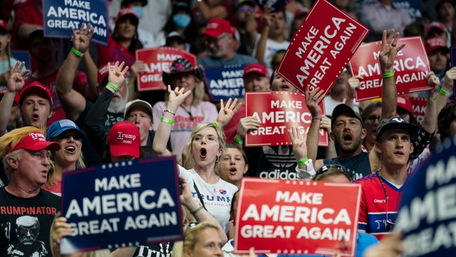 Supporters of President Donald Trump cheer during a campaign rally at the BOK Center, Saturday, June 20, 2020, in Tulsa, Okla. The lack of protective masks at the rally, as urged by public health officials to help stop the spread of COVID-19, has some Portsmouth City Councilors urging a facemask mandate ahead of Saturday's Trump rally in Portsmouth.