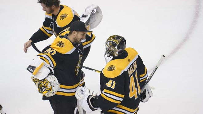 Boston Bruins goaltender Dan Vladar (80) and goaltender Jaroslav Halak (41) celebrate the 2-1 victory against the Carolina Hurricanes following game five of the first round of the 2020 Stanley Cup Playoffs at Scotiabank Arena on Aug. 19, 2020.