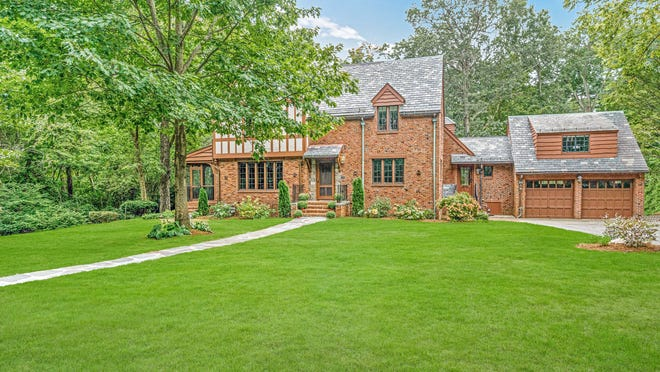 This beautifully renovated and expanded brick Tudor at 118 Hundreds Road offers 6,000 square feet of well-designed living space and a prime Wellesley Farms location.