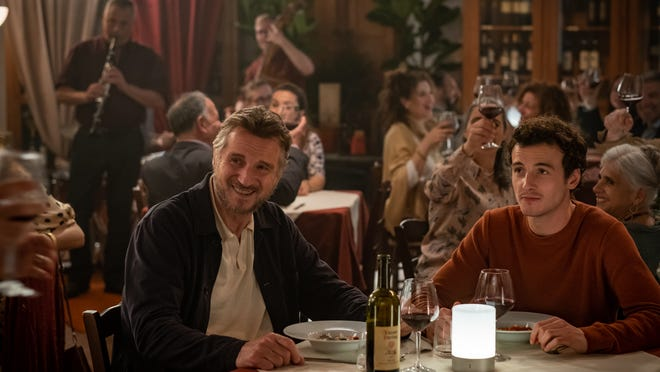 Father and son (Liam Neeson and Micheál Richardson) put aside their differences during a nice Italian meal.