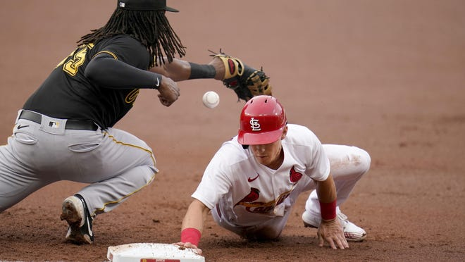 St. Louis Cardinals' Tommy Edman, right, dives back to first as Pittsburgh Pirates first baseman Josh Bell keeps the ball from bouncing away on a pickoff attempt Thursday in St. Louis.