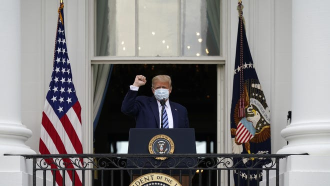 President Donald Trump arrives to speak from the Blue Room Balcony of the White House to a crowd of supporters, Saturday, Oct. 10, 2020, in Washington.