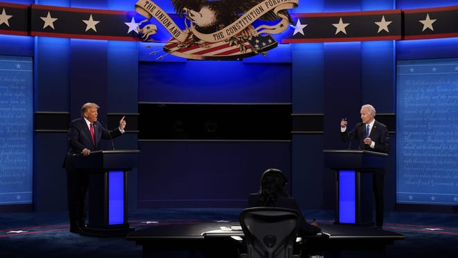President Donald Trump, left, and Democratic presidential candidate former Vice President Joe Biden face off during the second and final presidential debate Thursday at Belmont University in Nashville, Tenn.