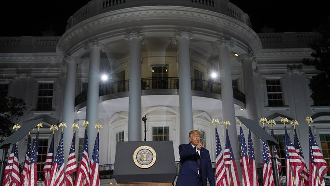 President Donald Trump gestures as he finishes his acceptance speech from the South Lawn of the White House on the fourth day of the Republican National Convention,.