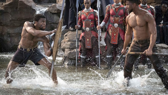 """Family Movie Night with """"Black Panther"""" at 7 p.m. Oct. 31 at Connors Temple Baptist Church, parking lot at 510 W. Gwinnett St. Shown - Chadwick Boseman, left, and Michael B. Jordan star as T'Challa and Erik Killmonger, respectively, in """"Black Panther."""""""
