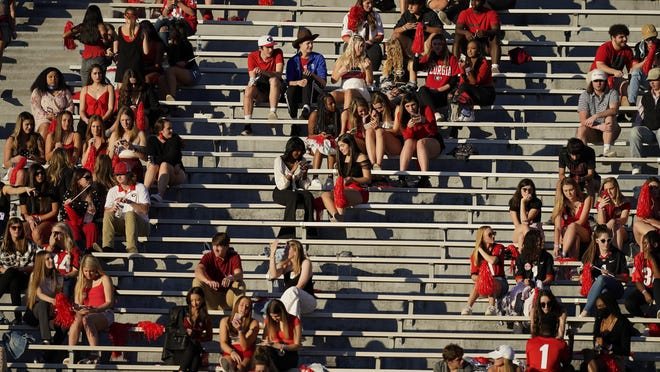 Georgia students gather in the stands before an NCAA college football game between Georgia and Auburn, Saturday, Oct. 3, 2020, in Athens, Ga.