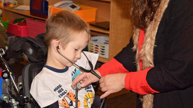 Julie Dantone, SNAP-Ed instructor implemented a new approach to her Organ Wise Guys curriculum in order to meet the needs of a student born without limbs. She now uses a stethoscope as one way to help students learn about their pulse rate after exercising. [Photo/University Illinois Extension]