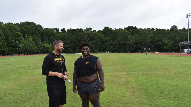 Richmond Hill head football coach Matt LeZotte, left, with Jay Kollman at a recent conditioning session.