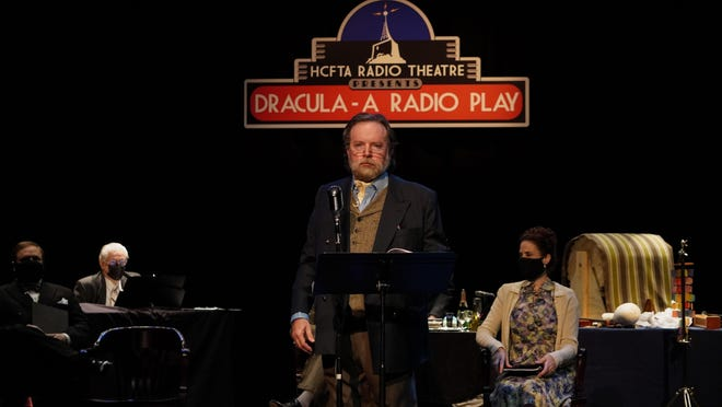 """Dennis Rendleman, center, as Dr. Van Helsing, with other cast and crew of """"Dracula -- A Radio Play,"""" a streamed adaptation presented by the Hoogland Center for the Arts."""