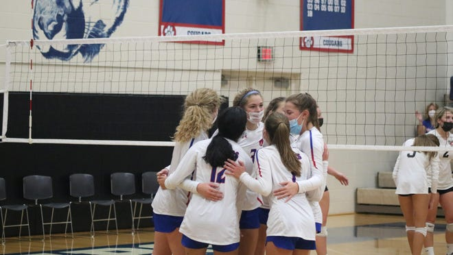 The Lenawee Christian volleyball team celebrates after winning a point in the third set of their match against Vandercook Lake during Saturday's quad meet.