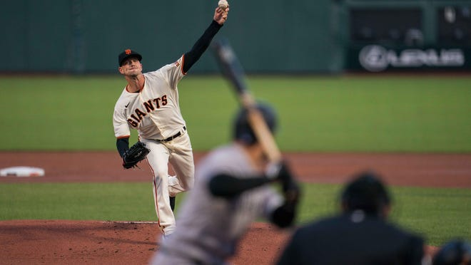 Drew Smyly (18) delivers a pitch for the San Francisco Giants at Oracle Park on Sept. 22. Smyly signed with the Atlanta Braves on Monday, his seventh MLB team.