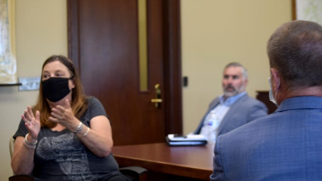 Commissioner Vicky Kaaz, left, speaks to an audience member during a work session of the County Commission on Wednesday at the Leavenworth County Courthouse. Also pictured is Commissioner Chad Schimke and Senior County Counselor David Van Parys.