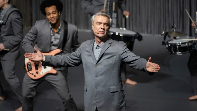 David Byrne fronts his barefooted cast of musicians.