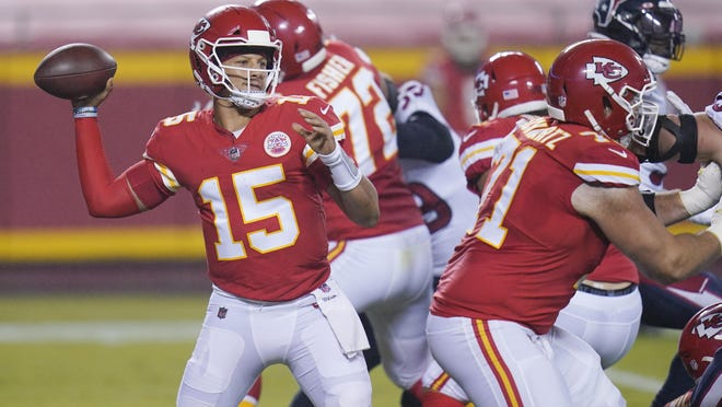 Kansas City Chiefs quarterback Patrick Mahomes, left, drops back to pass against the Houston Texans in the first half of Thursday night's NFL season opener in Kansas City, Mo.