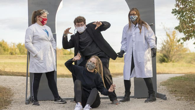 """Theater students and members of Seaman High's International Thespian Society pose by a haunted trail station meant to mimic """"Frankenstein."""" The haunted trail's theme this year was horror films like """"The Shining,"""" """"It"""" and """"Annabelle."""""""