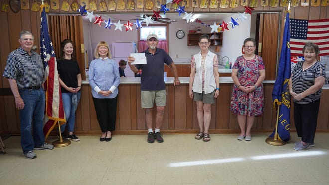 In celebrating the 100th Anniversary year of the American Legion and American Legion Auxiliary, members celebrated grants totaling $22,000 awarded to the American Legion Thomas J. Hogan Post 109 Hall Restoration Project, Phase II, in Natoma, Kansas.  Pictured are (left to right):  Terry Tucker, Arielle Tucker McLarty, Laah Tucker, William Workman, Linda Crawford, Shawna Dunlap, and Mary Murphy.